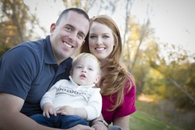 Young Attractive Parents and Child Portrait Outside