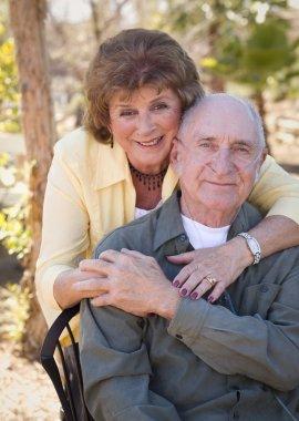 Senior Woman with Man Wearing Oxygen Tubes