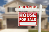 Foreclosure House For Sale Sign and House