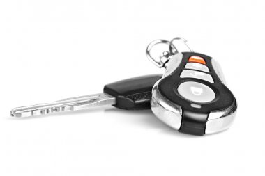 Car keys and remote alarm controller isolated onwhite