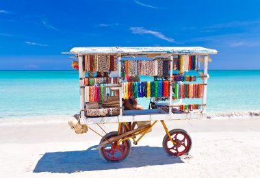 Cart selling typical souvenirs on the famous cuban beach of Varadero