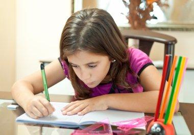 Small hispanic girl working on her homework
