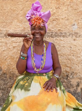 Typical cuban woman with a huge cigar