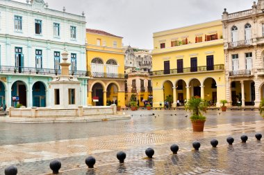 Raining in La Plaza Vieja,a landmark in Old Havana