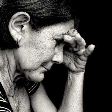 Black and white portrait of a very sad old woman