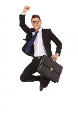 Business man with briefcase jumping