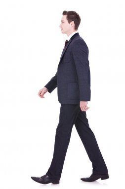 Picture of a young business man walking forward - side view stock vector
