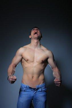 Muscle man scream