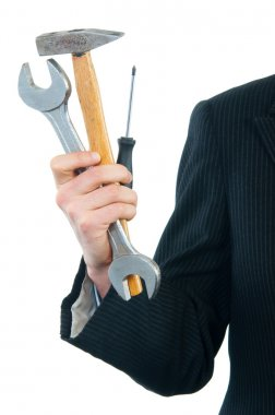 Businessman holding wrench, hammer and screwdriver isolated on white.