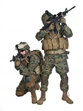 Two US marines with rifles in action stock vector