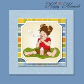 divertente bella bambina soffiando bolle di sapone