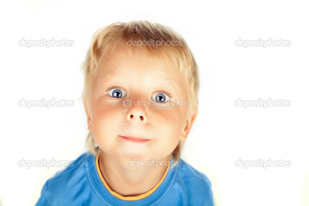 Funny kid with the big eyes close up. isolated on white backgrou