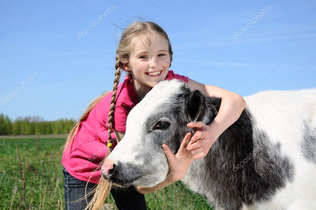 Little girl with calf