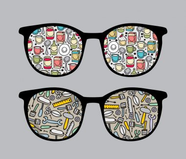Retro sunglasses with funny dishes and tools reflection in it.