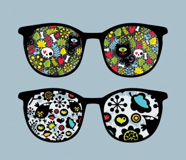 Retro sunglasses with cats and birds reflection in it.