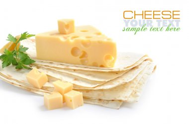 Pieces of cheese are on a pita on a white background