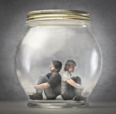 Man and woman sitting in a jar
