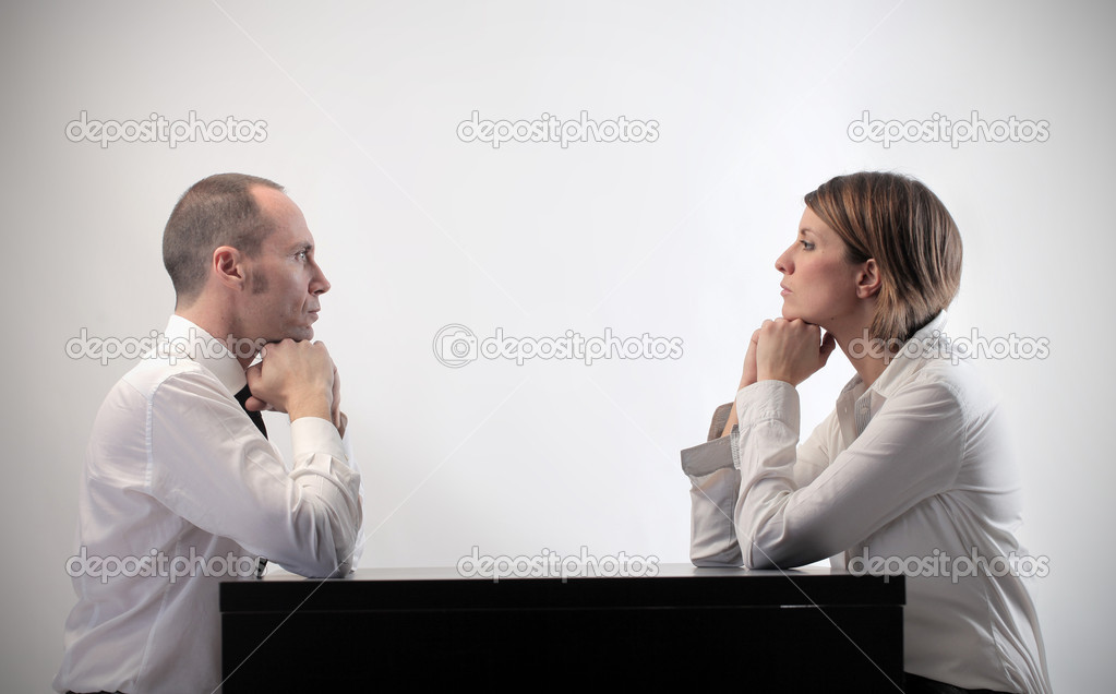 Two business sitting in front of each other