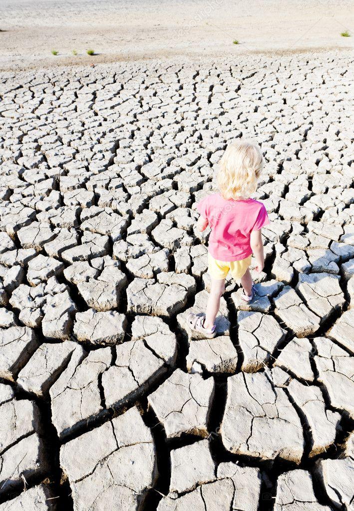 Little girl standing on dry land, Parc Regional de Camargue, Pro