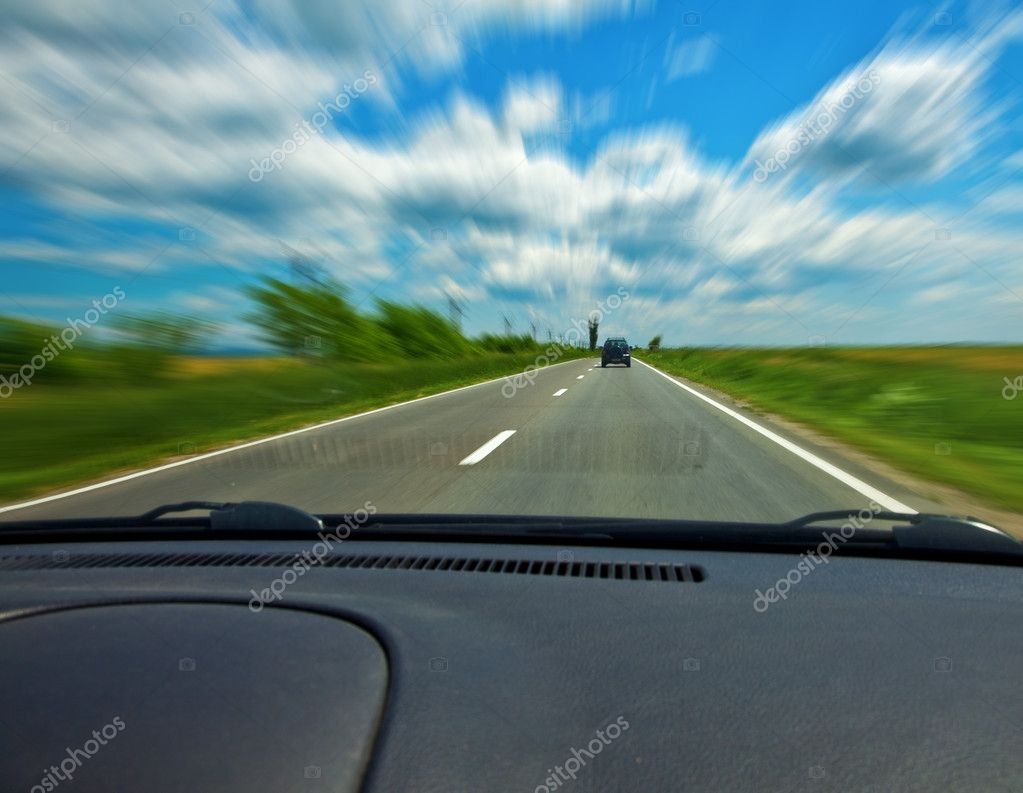 Fast car on road viewed from the interior