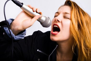 Portrait of female rock singer with microphone in hand stock vector