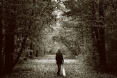 Fotografie Lonely sad woman on the wood road