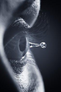Macro on eye with tears water droplet