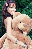 Happy cute woman and her teddy bear