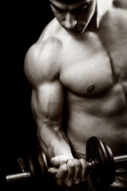 Gym and fitness concept - bodybuilder and dumbbell