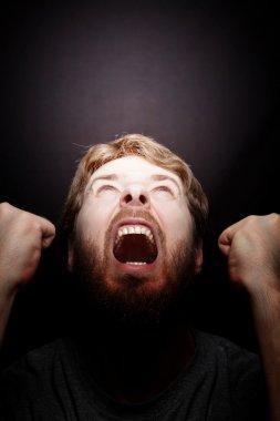 Scream of rebellion - angry furios man