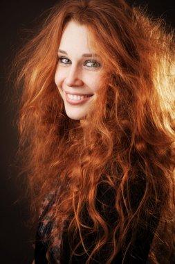 Redhead woman with beautiful long hair