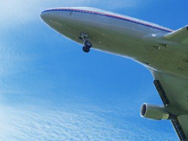 Airplane under sky