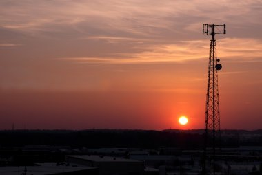 Dark Orange Cell Phone Tower Silhouette