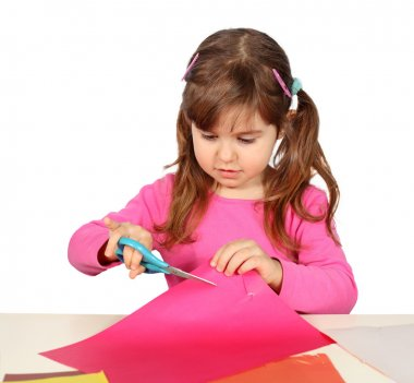 Little Child Girl Cutting with Scissors