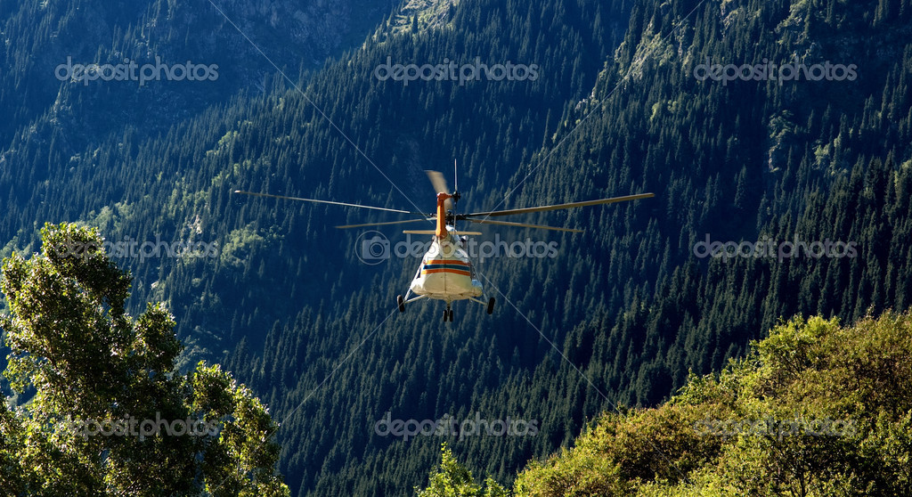 Rescue helicopter flies away in mountains