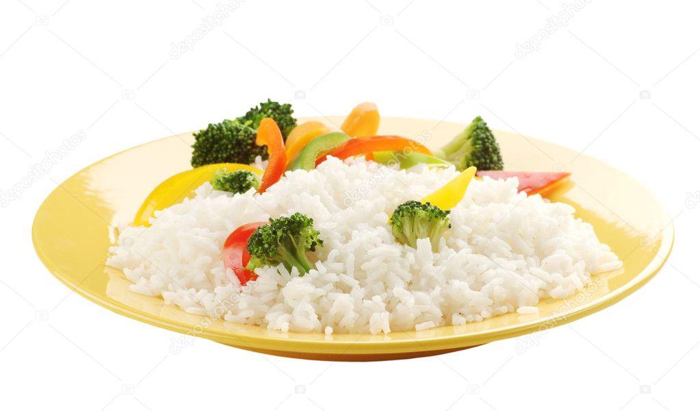 Boiled rice with vegetables on a yellow plate