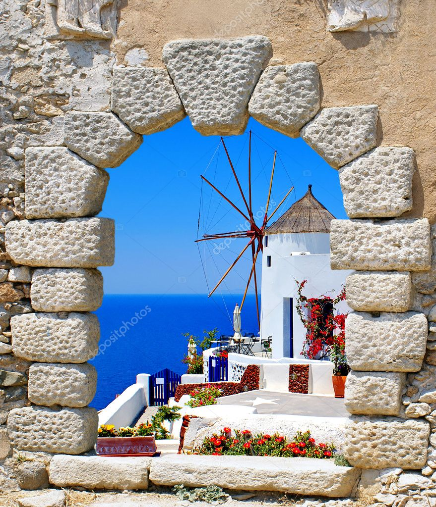 Windmill through an old window in Santorini island