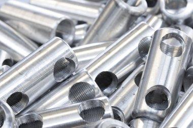 Metallic hardware