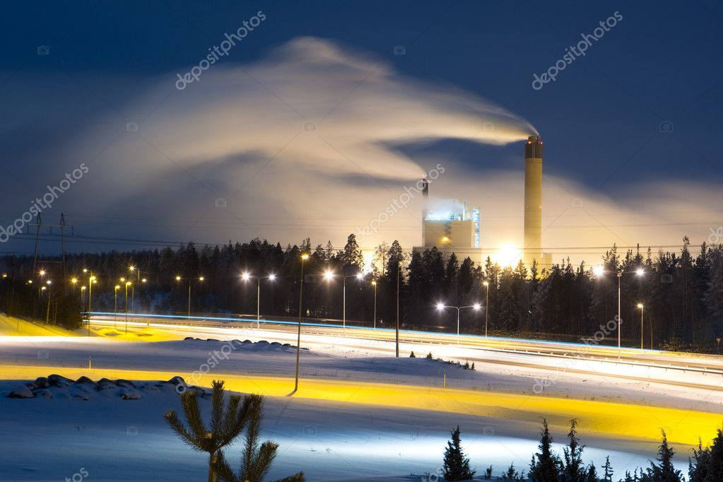 Power plant with smoke at night