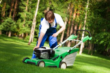 Lawn mower man start up the engine
