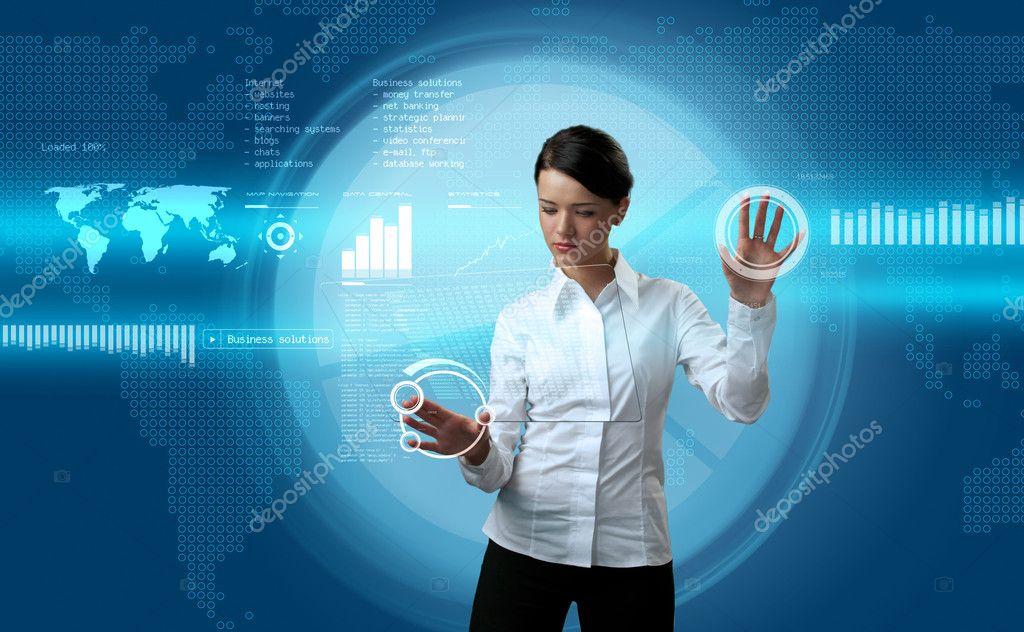 Attractive brunette navigating futuristic interface