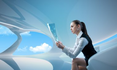Sexy businesswoman examining future digital report - newspaper (outstanding business in interiors - interfaces series)