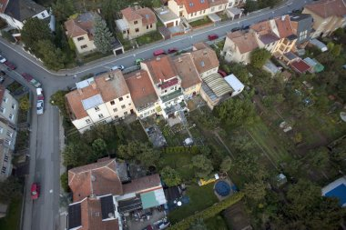Highly detailed aerial city view with crossroads, roads, houses,
