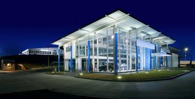 Exterior of a modern car salon, night scene. stock vector