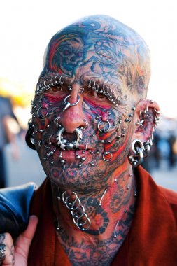 Face with tattoos and piercings