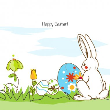 Easter scene, white rabbit and painted eggs