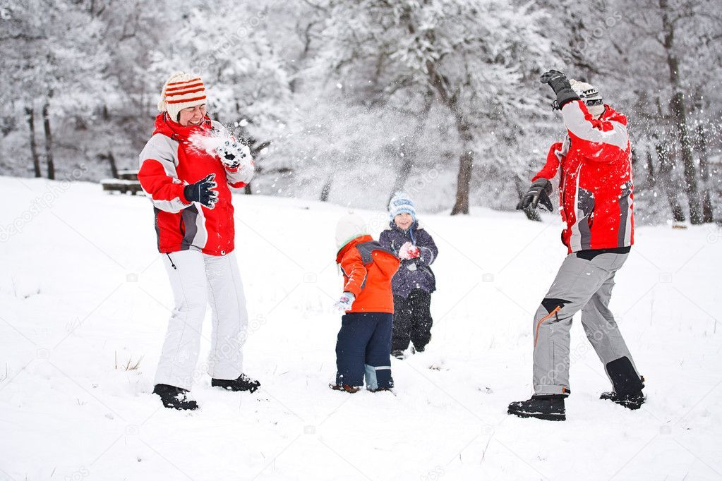Family playing with snow