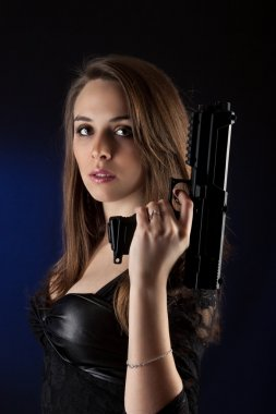 Girl posing with guns