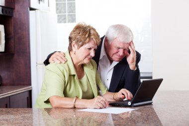 Senior couple worrying about money situation