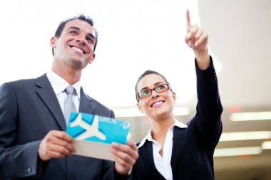 Businessman and businesswoman at airport
